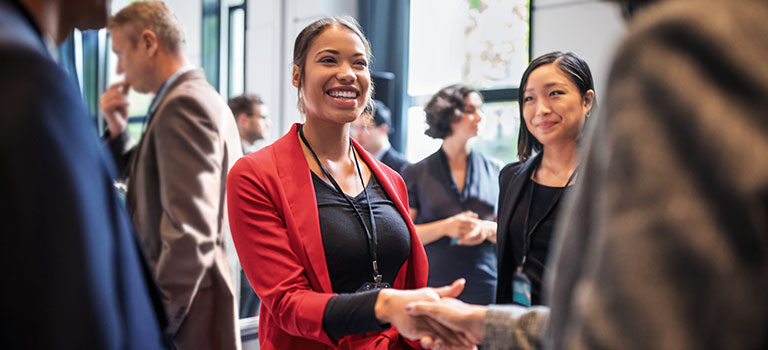 Young attorney meeting other legal professionals at a bar association networking event